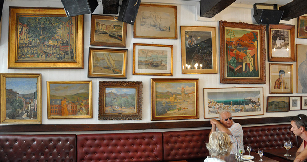 Original paintings on the wall of the Cafe des Templier